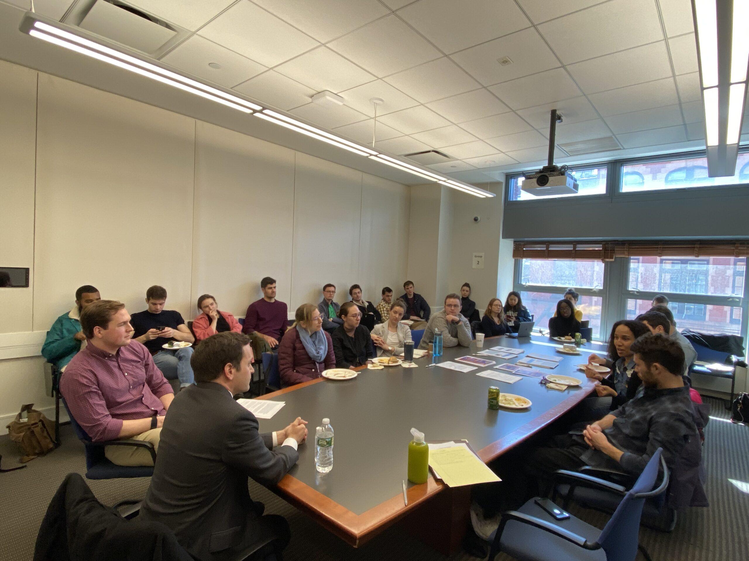 Vance Serchuk speaks with students