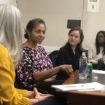 Anna Makanju speaks with students